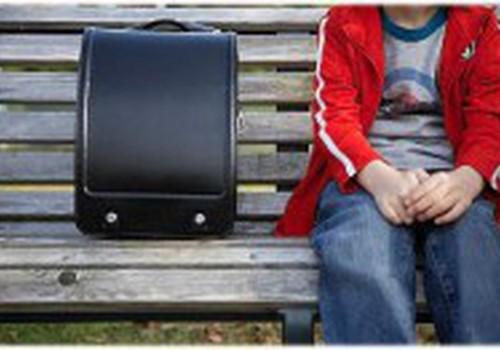 Как правильно носить школьный портфель